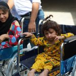 Girls with disabilities sitting on wheelchairs